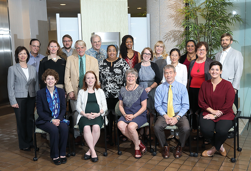 Photo of Prevention Research Coordinating Committee (PRCC) members posing in a building lobby during the June 2019 PRCC retreat.